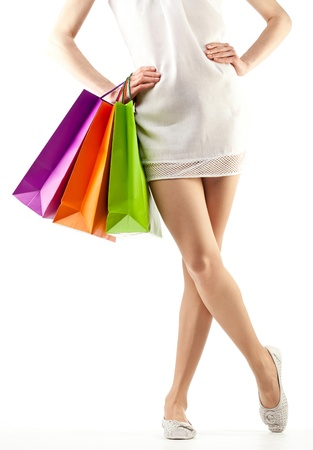 Girl holding multicolored shopping paper bags - closeup shot on white background Stock Photo - 14033052