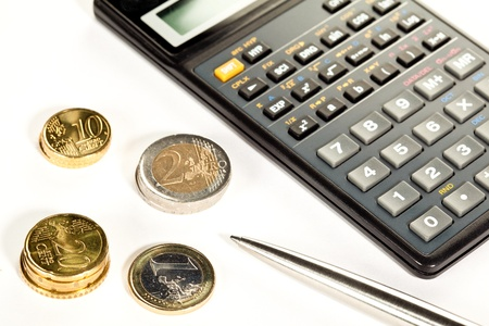 increment: Increment of capital: euro coins, calculator and a pen