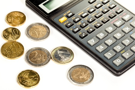 increment: Increment of capital: euro coins and calculator Stock Photo