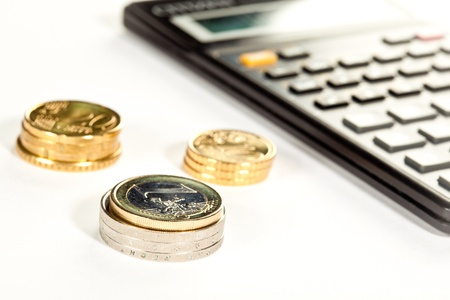 increment: Increment of capital: euro coins and calculator in the background Stock Photo