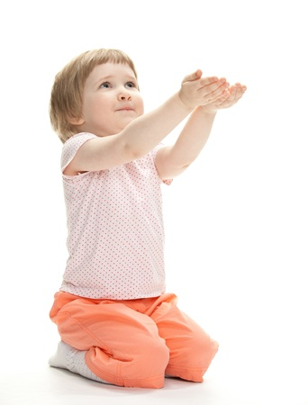 Little girl reaching her hands out, isolated on white