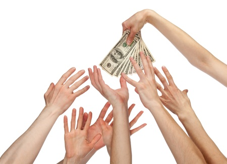 Many hands wanting to take money (bonus, salary or other payment); many hands reaching out for dollar banknotes isolated on white photo