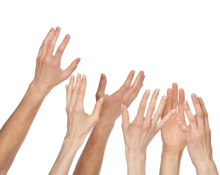 Many hands wanting/asking for something - copyspace, you can add your text or picture; isolated over white background Foto de archivo