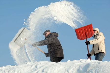 Amazing snow removal - people shovelling snow after snowfall photo