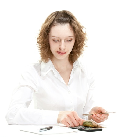 Attractive young woman counting money; young accountantbookkeeperbusinesswoman isolated on white photo