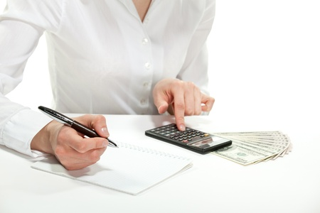 Female accountant calculating revenues and costs, isolated on white