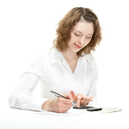 Attractive young woman calculating revenues and costs; young accountant/bookkeeper/businesswoman isolated on white Stock Photo - 14250457