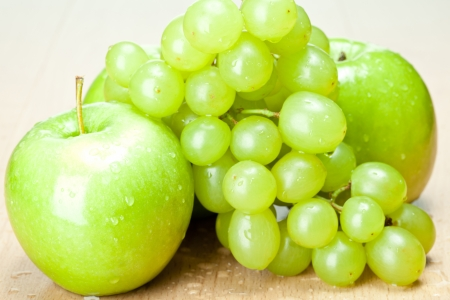 Green apples and grapes on the table - healthy eating concept Stock Photo - 14594469