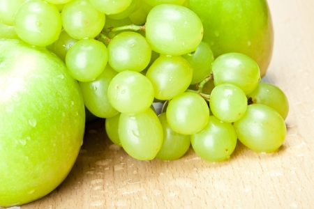 Green apples and grapes on the table - healthy eating concept Stock Photo - 14594528