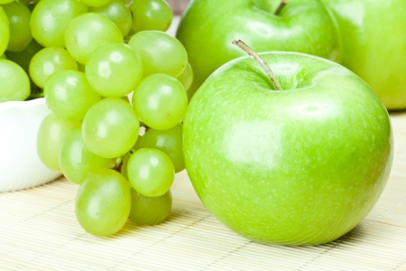 Green apples and grapes on the table - healthy eating concept photo