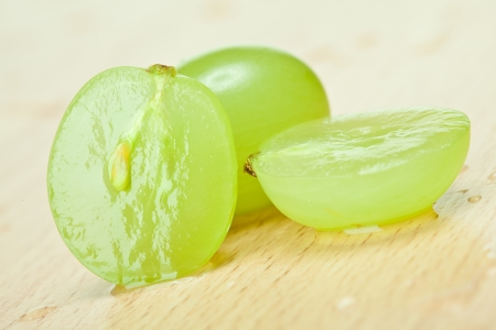 Juicy green grapes - macro shot of whole and cut berries on wooden background Stock Photo - 14594468