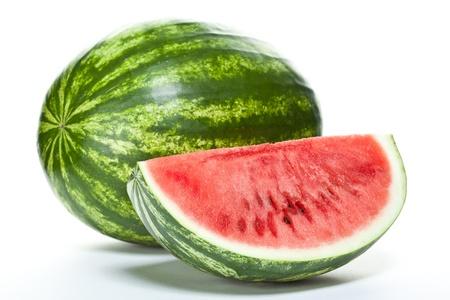 Close-up van watermeloen (geheel en slice) op een witte achtergrond Stockfoto