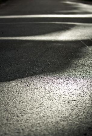 Wet asphalt - road textural background photo