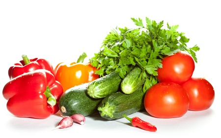 Vegetable assortment: raw fresh summer vegetables on white background