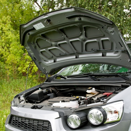 An open bonnet and engine, storage battery (accumulator) of a modern car photo