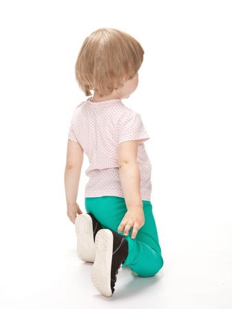 Rear view of little girl on white background Foto de archivo