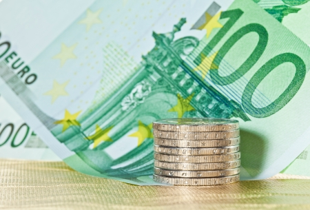 Stacked coins and euro banknotes photo