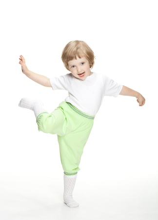 Happy playful little girl jumping and dancing on white background photo