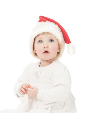 first miracle: Cute baby girl in Santas hat