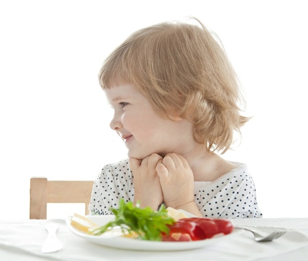 Healthy eating for a pretty little girl isolated on white Stock Photo