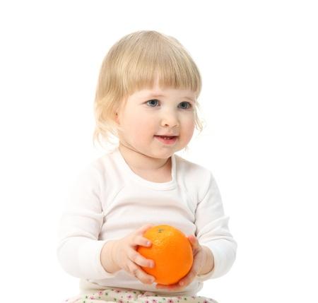 Happy little baby holding orange Stock Photo - 15677445