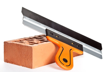 special steel: Construction putty knife and a brick