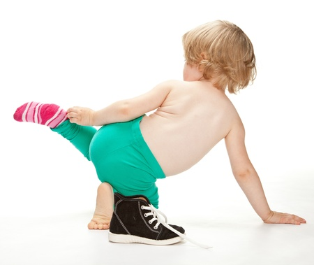 Little child getting undressed Stock Photo