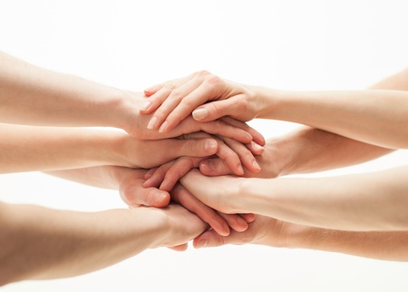 держась за руки: Руки группы Фото со стока
