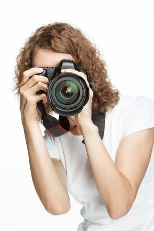 Girl taking a picture using digital camera photo