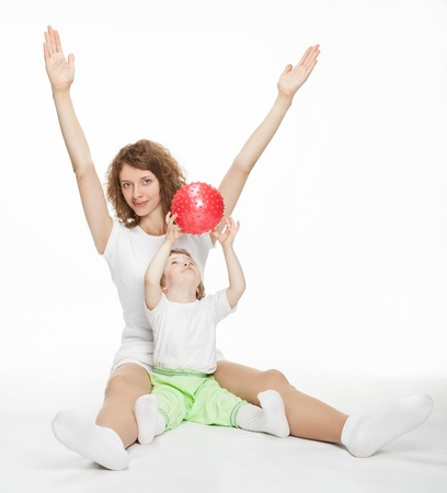 Happy mother doing sport exercises with little daughter Stock Photo - 16141407