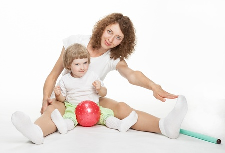 Happy mother doing sport exercises with little daughter Stock Photo - 16141485