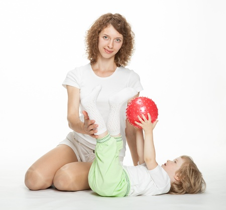 Happy mother doing sport exercises with little daughter Stock Photo - 16141455