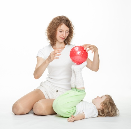 Happy mother doing sport exercises with little daughter Stock Photo - 16141469