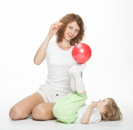 Happy mother doing sport exercises with little daughter Stock Photo - 16141491