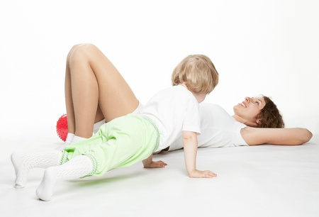 Happy mother doing sport exercises with little daughter Stock Photo - 16141471