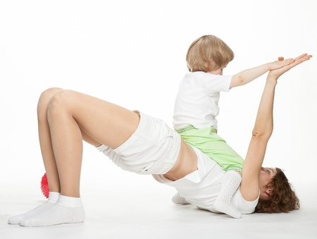 Happy mother doing sport exercises with little daughter Stock Photo - 16141465