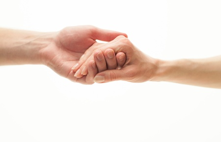 Hands of man and woman holding together Stock Photo