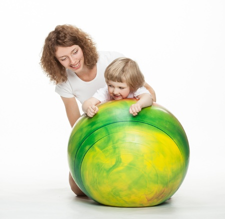 Happy mother doing sport exercises with little daughter Stock Photo - 16483148
