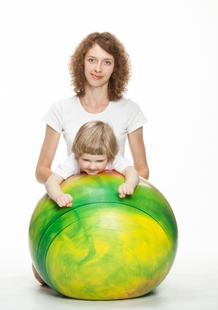 Happy mother doing sport exercises with little daughter photo