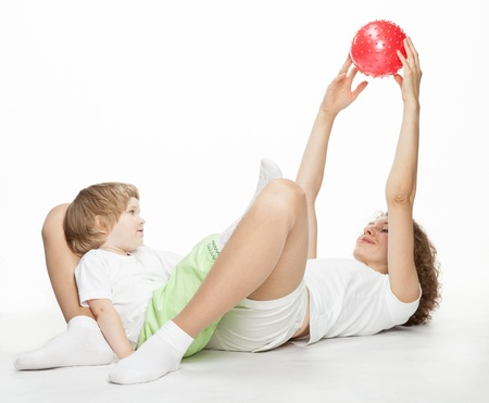 Happy mother doing sport exercises with little daughter Stock Photo - 16483171