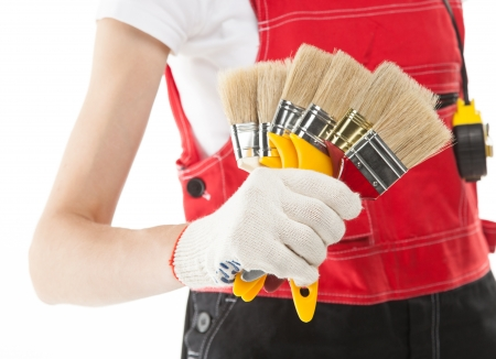 Construction worker in uniform with brushes photo