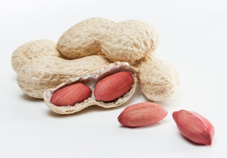 groundnut: Handful of groundnut on white background Stock Photo