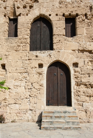 Closed wooden doors of medieval fortress, Cyprus Stock Photo - 16567176