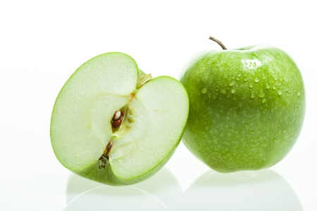 kw: Green apple and slice on white background