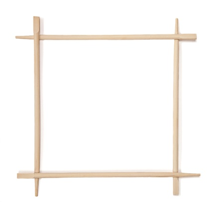 Decorative frame of bamboo chopsticks isolated on a white photo