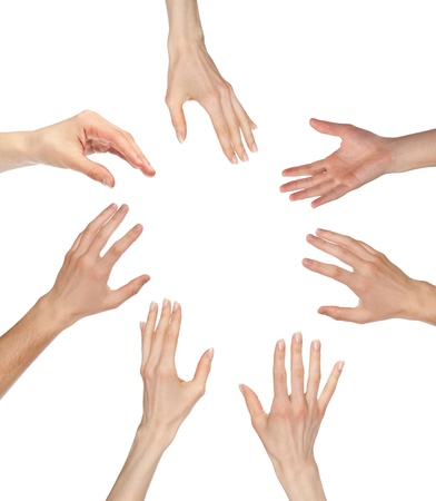 Many hands asking for something reaching out to the center of image - copyspace, you can add your text or picture; isolated over white background Foto de archivo