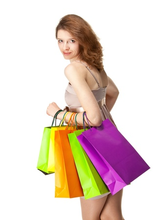 Attractive girl holding multicolored shopping paper bags - closeup shot on white background Stock Photo - 17564663