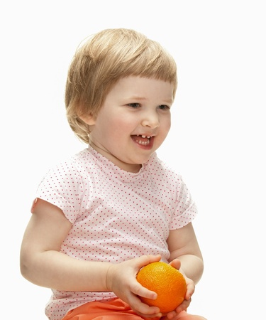 Happy laughing child playing with orange, isolated on white Stock Photo - 17564669