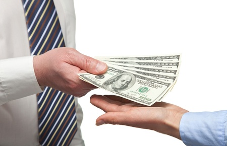Human hands exchanging money on white background