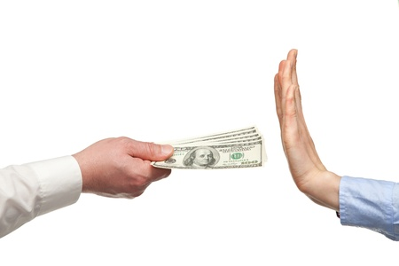 Human hands rejecting an offer of money on white background photo